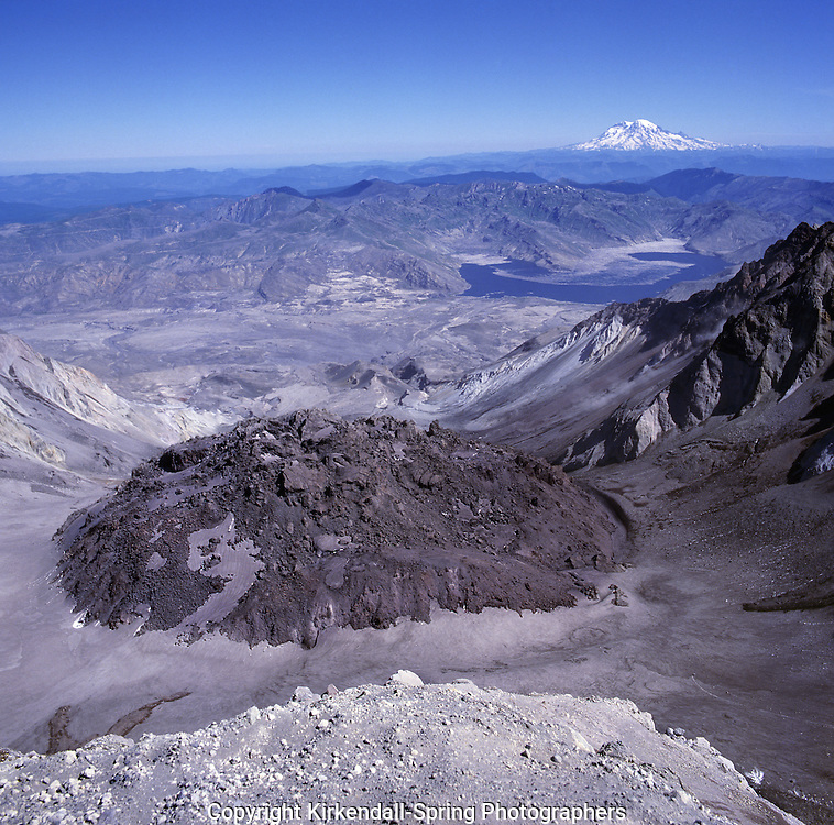 BB01613-02...WASHINGTON - Dome growing in the blown-out crater of Mount St. Helens with Spirit Lake and Mount Rainier in the distance in Mount St. Helens National Volcanic Monument.