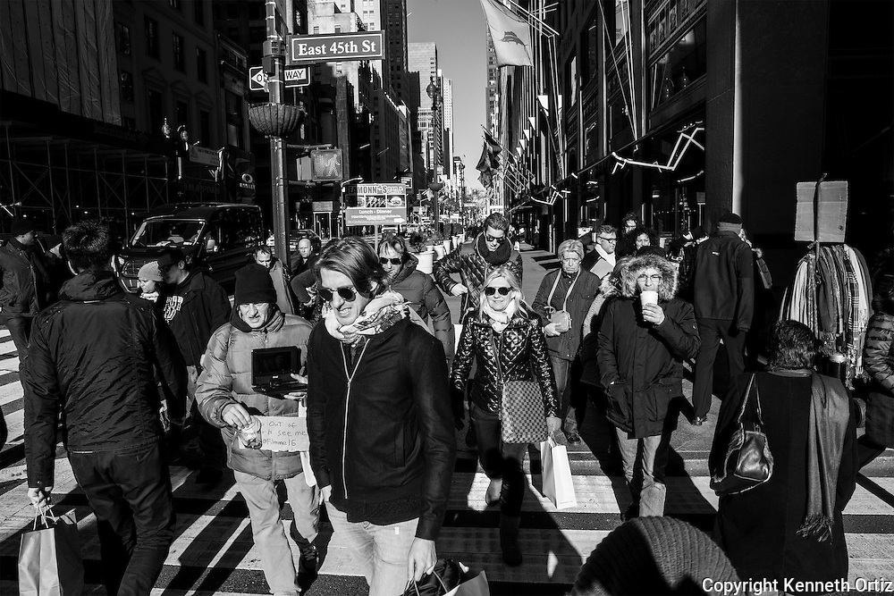 A crowded street on 5th Avenue during a sunny winter day.