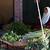 North Africa, Morocco, Fes. Vegetable vendor in Fes Souk.