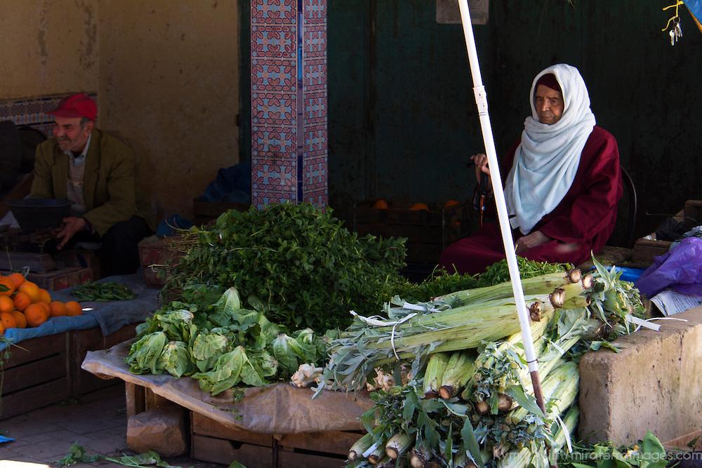 North Africa, Morocco, Fes. Vegetable vendor in Fes Souk.