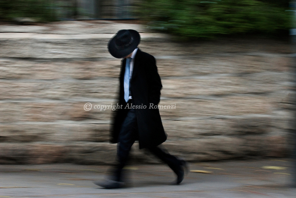 JERUSALEM: An Ultra Orthodox walking away from the demonstration in the Jerusalem ultra-Orthodox neighbourhood of Mea Sharim against the opening of a car park during the Sabbath on December 12, 2009. Ultra-Orthodox Jews have been protesting against a decision by secular Mayor Nir Barkat to open the car park on the Sabbath, the Jewish day of rest which runs from Friday sundown to Saturday sundown..© ALESSIO ROMENZI