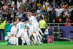 Players of Real Madrid celebrate after Karim Benzema of Real Madrid scored during the UEFA Champions League final football match between Liverpool and Real Madrid at the Olympic Stadium in Kiev, Ukraine on May 26, 2018.Photo by Sandi Fiser / Sportida