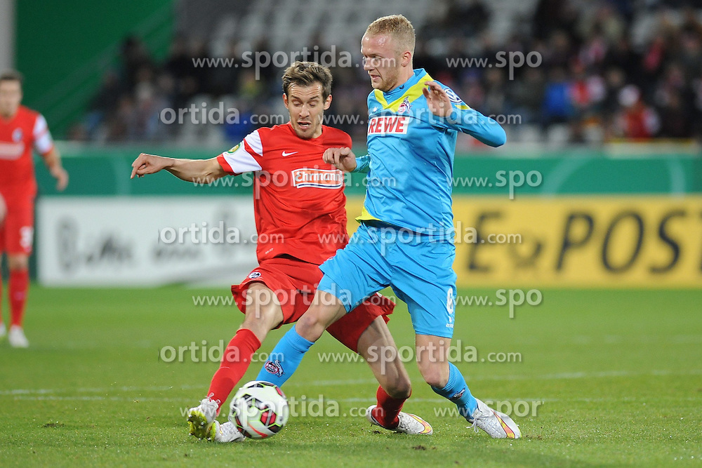 03.03.2015, Mage Solar Stadion, Freiburg, GER, DFB Pokal, SC Freiburg vs 1. FC Koeln, Achtelfinale, im Bild (l.) Julian Schuster (SC Freiburg) im Zweikampf, Aktion, mit (r.) Kevin Vogt (1. FC Koeln) // during German DFB Pokal last sixteen match between SC Freiburg and 1. FC Koeln at the Mage Solar Stadion in Freiburg, Germany on 2015/03/03. EXPA Pictures &copy; 2015, PhotoCredit: EXPA/ Eibner-Pressefoto/ Laegler<br /> <br /> *****ATTENTION - OUT of GER*****