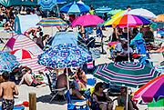 Crowded summer beach with colorful umbrellas, Nauset Beach, Cape Cod National Seashore, Cape Cod, Massachusetts, USA.