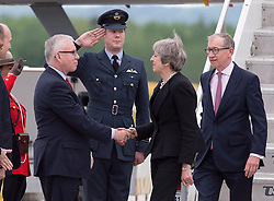 British Prime Minister Theresa May and her husband Philip May, right, are greeted by Canada's protocol chief Dr. Roy Norton as they arrive at CFB Bagotville, Quebec, Canada for the annual summit of G7 leaders on Thursday, June 7, 2018. The event will be held in La Malbaie, in the Charlevoix region of Quebec. Photo by Andrew Vaughan/CP/ABACAPRESS.COM