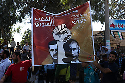 "October 14, 2017 - A ""Day of Rage"" demonstration takes place in Anjara, in the western Aleppo countryside. The demonstration is part of a series of rallies in opposition-controlled territories of Syria calling for the fall of the Syrian regime of Bashar al-Assad, to denounce what they describe as the massacres committed by the Russian airplanes in Syria, as well as to remember those who died and went to prison as they joined the Syrian revolution (Credit Image: © Juma Mohammed/ImagesLive via ZUMA Wire)"