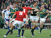 Pierre Spies of the Springboks on the charge with Stephen Jones of the Lions trying to stop him.<br /> Rugby - 090704 - Springboks vs British&Irish Lions - Coca-Cola Park - Johannesburg - South Africa. The Lions won the third test 28-9 but lost the series 2-1 to the Springboks.<br /> Photographer : Anton de Villiers / SASPA