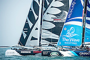 Emirates Team New Zealand and The Wave, Race day one of the Land Rover Extreme Sailing Series regatta in Qingdao, China. Blair Tuke, Glenn Ashby and Peter Burling. 1/5/2014