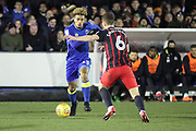 AFC Wimbledon striker Lyle Taylor (33) battles for possession with Blackburn Rovers midfielder Richard (Richie) Smallwood (6) during the EFL Sky Bet League 1 match between AFC Wimbledon and Blackburn Rovers at the Cherry Red Records Stadium, Kingston, England on 27 February 2018. Picture by Matthew Redman.