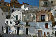 "Pisticci. Traditional architecture of ""Dirupo"" (""precipice"") district. After the Earthquake february 9 of 1688, with more than 4000 deaths the survivors reconstructed 200 white houses , all with the same traditional architecture."