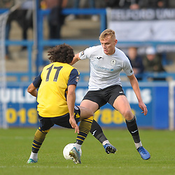 TELFORD COPYRIGHT MIKE SHERIDAN William Sass-Davies of Telford (on loan from Crewe Alexandra) takes on Aaram Soleman during the Vanarama National League Conference North fixture between AFC Telford United and Guiseley on Saturday, October 19, 2019.<br /> <br /> Picture credit: Mike Sheridan/Ultrapress<br /> <br /> MS201920-026