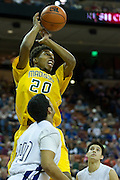 Devonte Robinson (20) of Dallas Madison goes for a rebound against Abilene Wylie during the UIL Conference 3A semifinals at the Frank Erwin Center in Austin on Thursday, March 7, 2013. (Cooper Neill/The Dallas Morning News)