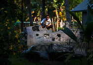 A wrecked American plane has become a giant playground for the local kids, Rabaul, New Britain Island, Papua New Guinea