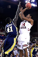 26 November 2005: USC Gamecock senior forward/center, Antoine Tisby (14), takes a shot over Marquette's Ousmane Barro (41) in the South Carolina Gamecock overtime loss, 89-92, to the Golden Eagles of Marquette in the final game of the Great Alaska Shootout in Anchorage, Alaska