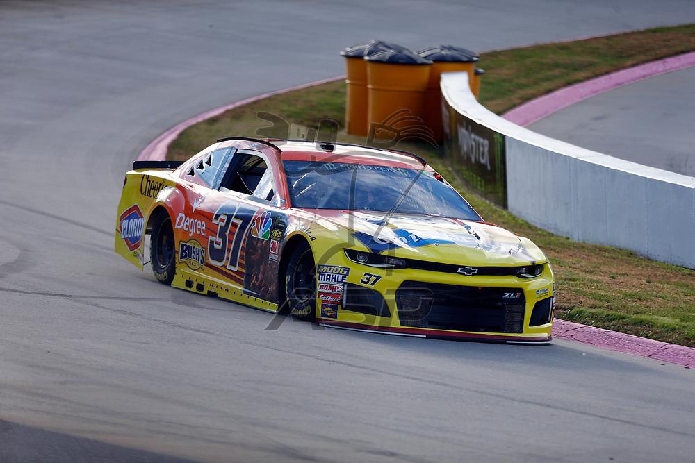 Chris Buescher (37) races through turn three to practice  for the First Data 500 at Martinsville Speedway in Martinsville, Virginia.
