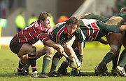 © Peter Spurrier/ Intersport Images.Photo Peter Spurrier.01/03/2003 Sport - Semi final Powergen Cup Rugby -.Leicester  v Gloucester - Franklin Gardens.Andy Gomersall left tackles his counterpart Jamie Hamilton. .