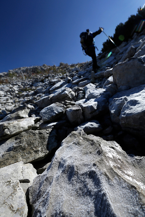 Kenan Muftic of Via Dinarica taem, hiking on  in cold wind creating conditions for frost, Dinara mountain, <br /> Croatia.