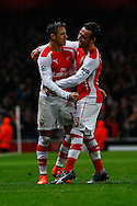 Alexis Sanchez of Arsenal (left) celebrates scoring his team's second goal against R.S.C Anderlecht to make it 2-0 with Santi Cazorla of Arsenal (right) during the UEFA Champions League match at the Emirates Stadium, London<br /> Picture by David Horn/Focus Images Ltd +44 7545 970036<br /> 04/11/2014