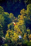 NEW RIVER GORGE, WV:  Two B.A.S.E. jumping parachutists approach the bottom of the New River Gorge, West Virginia.  During bridge day, a annual event held at the New River Gorge, BASE jumpers from around the world flock to West Virginia to jump off the highest span bridge in the western hemisphere.