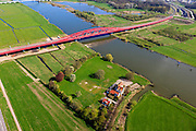 Nederland, Gelderland - Overijssel, Hattem, 01-05-2013; IJsselbrug, spoorbrug bij Hattem voor de Hanzelijn. In de achtergrond de brug voor regionaalautoverkeer en de brug in rijksweg A28 naar Zwolle. IJsselstein in de voorgrond.<br /> De 'Hanzeboog' is ontworpen door  Quist Wintermans Architecten.<br /> Bridges over the river IJssel near Zwolle. The red railway bridge Hanzeboog (Hanseatic arch) over the IJssel near Zwolle, has been designed by Quist Wintermans Architects.  <br /> luchtfoto (toeslag op standard tarieven);<br /> aerial photo (additional fee required);<br /> copyright foto/photo Siebe Swart