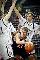 JEROME A. POLLOS/Press..Lake City High's Mark Smyly tries to find a way out of a trap set by Rocky Mountain High Friday at the state 5A boys basketball tournament at Idaho Center in Nampa.