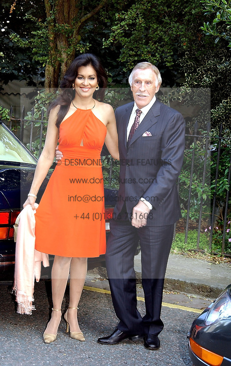 TV presenter BRUCE FORSYTH and his wife WILNELIA at Sir David & Lady Carina Frost's annual summer party held in Carlyle Square, London on 6th July 2004.