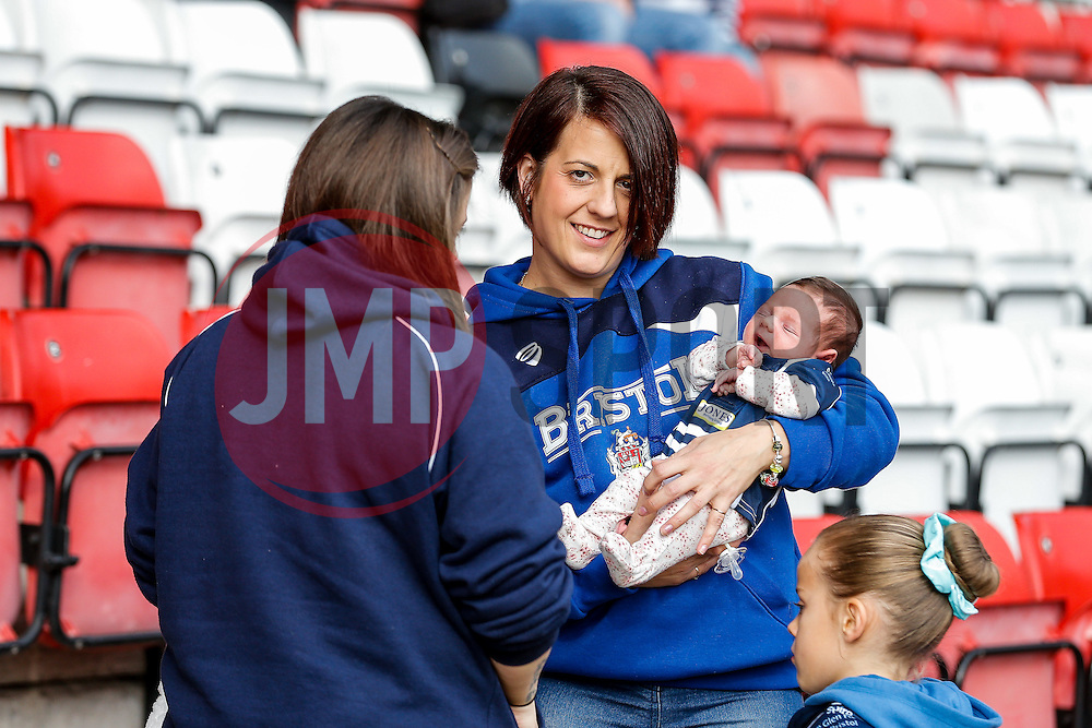 A Bristol Rugby supporter with her baby in the stands - Mandatory byline: Rogan Thomson/JMP - 07966 386802 - 04/10/2015 - RUGBY UNION - Ashton Gate Stadium - Bristol, England - Bristol Rugby v Rotherham Titans - Greene King IPA Championship.