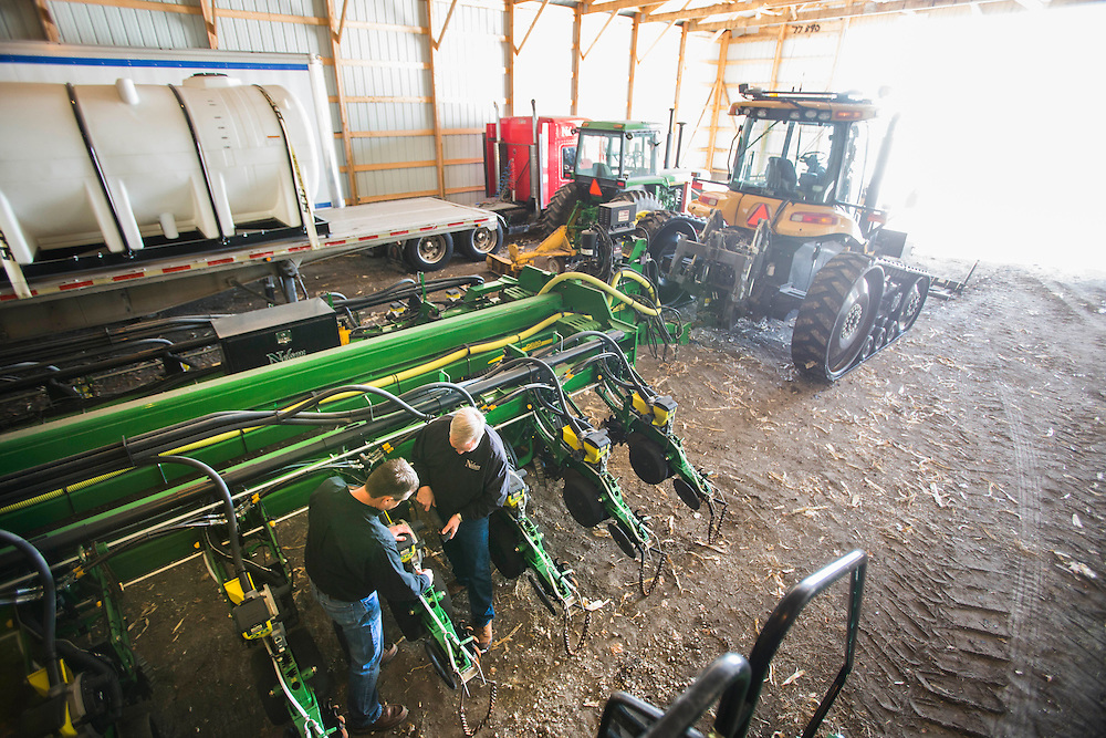 Farmers David (left) and Gary Nelson look over their state-of-the-art planter in the machine shed on their farm near Fort Dodge, Iowa, on February, 18, 2014.