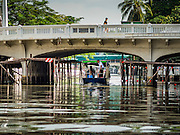 09 SEPTEMBER 2016 - BANGKOK, THAILAND:  A passenger boat on Khlong Phadung Krung Kasem. Trial services have started on a 5-kilometre boat route on Khlong Phadung Krung Kasem between Hua Lamphong and Thewes piers. The service is operated by the Bangkok Metropolitan Administration (BMA). The city is using converted garbage boats, fitted with seats, awnings and life preservers. If the trial run is successful regular passenger boats will be put on the route.      PHOTO BY JACK KURTZ