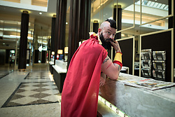 © Licensed to London News Pictures . 25/07/2015 . Manchester , UK . The Midland Hotel . Visitors to Comic Con on the streets of Manchester after venue - Manchester Central's - doors are shut . Photo credit : Joel Goodman/LNP