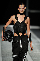 Karlie Kloss walks the runway wearing Alexander Wang for H&M in New York on October 16th, 2014