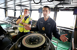 Lieutenant Commander and Navigator Jeremy Brettell (right) makes final preparations on the bridge ahead of sea trials this summer, for the Royal Navy's new aircraft carrier HMS Queen Elizabeth, at Rosyth Dockyard in Dunfermline.