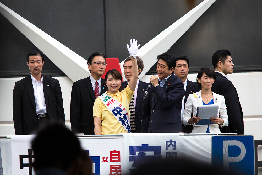 TOKYO, JAPAN - JULY 1: Japanese Prime Minister Shinzo Abe, president of the ruling Liberal Democratic Party, delivers his speech for his candidate Aya Nakamura to voters from atop of a campaign van with party's members during election campaign for Tokyo Metropolitan Assembly on July 1, 2017 in Akihabara, Tokyo, Japan. (Photo: Richard Atrero de Guzman/NUR Photo)