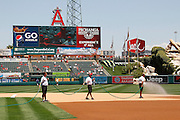 ANAHEIM, CA - JULY 21:  Members of the grounds crew water the infield before the Los Angeles Angels of Anaheim game against the Texas Rangers on Saturday, July 21, 2012 at Angel Stadium in Anaheim, California. The Rangers won the game 9-2. (Photo by Paul Spinelli/MLB Photos via Getty Images)