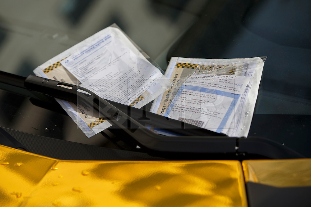 © Licensed to London News Pictures. 30/03/2016. London, UK. Parking fines left on one of the supercars covered in gold chrome wrap parked in Knightsbridge, London on Wednesday, 30 March 2016. Cars believed to be owned by a tourist from Saudi Arabia. Photo credit: Tolga Akmen/LNP