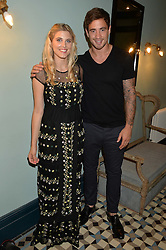 ASHLEY JAMES and DANNY CIPRIANI at the launch of Give Me Sport Magazine held at Library, 112 St.Martin's Lane, London on 30th July 2014.