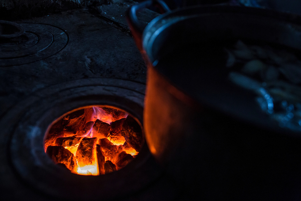 SNEZHNE, UKRAINE - JANUARY 25, 2015: Soup cooks over a coal-fired stove in Snezhne, Ukraine. The area is well known for its many coal mines, both large operations and small backyard operations. CREDIT: Brendan Hoffman for The New York Times