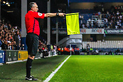 Assistant Referee Darren Cann flags Queens Park Rangers forward Jordan Hugill (9) (not in picture) off-side during the EFL Sky Bet Championship match between Queens Park Rangers and Swansea City at the Kiyan Prince Foundation Stadium, London, England on 21 August 2019.