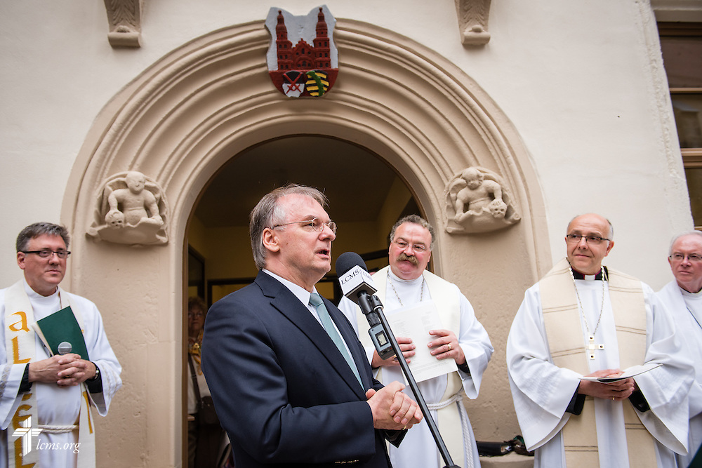 Dignitaries address a crowd for the dedication of the International Lutheran Center at the Old Latin School on Sunday, May 3, 2015, in Wittenberg, Germany. The building is a culmination of the joint effort by the LCMS, the Independent Evangelical Lutheran Church (SELK), and the International Lutheran Society of Wittenberg (ILSW), to establish a distinctly Lutheran presence in the very cradle of the Reformation. LCMS Communications/Erik M. Lunsford