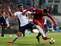 PODGORICA, MONTENEGRO - MARCH 25: England's Kyle Walker and Montenegro's Marko Vesovic during the 2020 UEFA European Championships group A qualifying match between Montenegro and England at Podgorica City Stadium on March 25, 2019 in Podgorica, Montenegro. (MB Media)