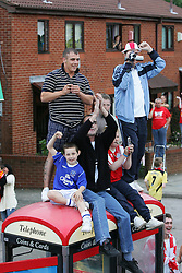 LIVERPOOL, ENGLAND - THURSDAY, MAY 26th, 2005: Liverpool and Everton fans cheer as the players parade the European Champions Cup on on open-top bus tour of Liverpool in front of 500,000 fans after beating AC Milan in the UEFA Champions League Final at the Ataturk Olympic Stadium, Istanbul. (Pic by David Rawcliffe/Propaganda)