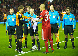 LIVERPOOL, ENGLAND - Wednesday, December 15, 2010: Liverpool's captain Martin Skrtel swaps pennants with FC Utrecht's captain Michael Silberbauer during the UEFA Europa League Group K match at Anfield. (Photo by: David Rawcliffe/Propaganda)