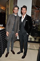 Left to right, hairstylist and groomer LARRY KING and DAVID GANDY at a reception hosted by Wei Koh founder of The Rake Magazine and Thomas Kochs General Manager of Claridge's to celebrate London Collections: Man 2014 at Claridge's, Brook Street, London on 5th January 2014.