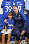 AFC Wimbledon striker Joe Pigott (39), Mascot during the EFL Sky Bet League 1 match between AFC Wimbledon and Bristol Rovers at the Cherry Red Records Stadium, Kingston, England on 21 September 2019.
