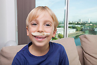 Little boy with artificial mustache