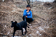 "Portrait of a young resident of the Roma part on the hill of the district ""Podsadek"", located in a little valley. The city of Stara Lubovna is located about 100 km from Kosice in northeast Slovakia. The town has a population of 16350, of whom 2 060 (13%) are of Roma origin. The majority of Roma live in the Podsadek district, where 980 (74%) out of 1330 inhabitants are Roma."