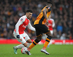 Alex Oxlade-Chamberlain of Arsenal looks to take the ball past Moses Odubajo of Hull City - Mandatory byline: Paul Terry/JMP - 20/02/2016 - FOOTBALL - Emirates Stadium - London, England - Arsenal v Hull City - FA Cup Fifth Round