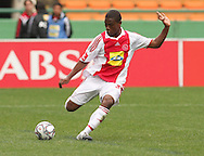 THULANI HLATSHWAYO looks to send the ball up field during the PSL match between Ajax Cape Town and Bidvest Wits held at Newlands Stadium in Cape Town on 13 September2009 ..Photo by Shaun Roy/www.sportzpics.net.+27 21 785 6814..