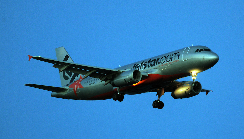 jetstar A320 Airbus approaches the airport early evening, Wellington, New Zealand, Monday 28, 2013. Credit:SNPA / Ross Setford