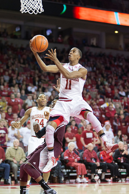 FAYETTEVILLE, AR - JANUARY 23:  BJ Young #11 of the Arkansas Razorbacks goes up for a lay up against the Mississippi State Bulldogs at Bud Walton Arena on January 23, 2013 in Fayetteville, Arkansas. The Razorbacks defeated the Bulldogs 96-70.  (Photo by Wesley Hitt/Getty Images) *** Local Caption *** BJ Young